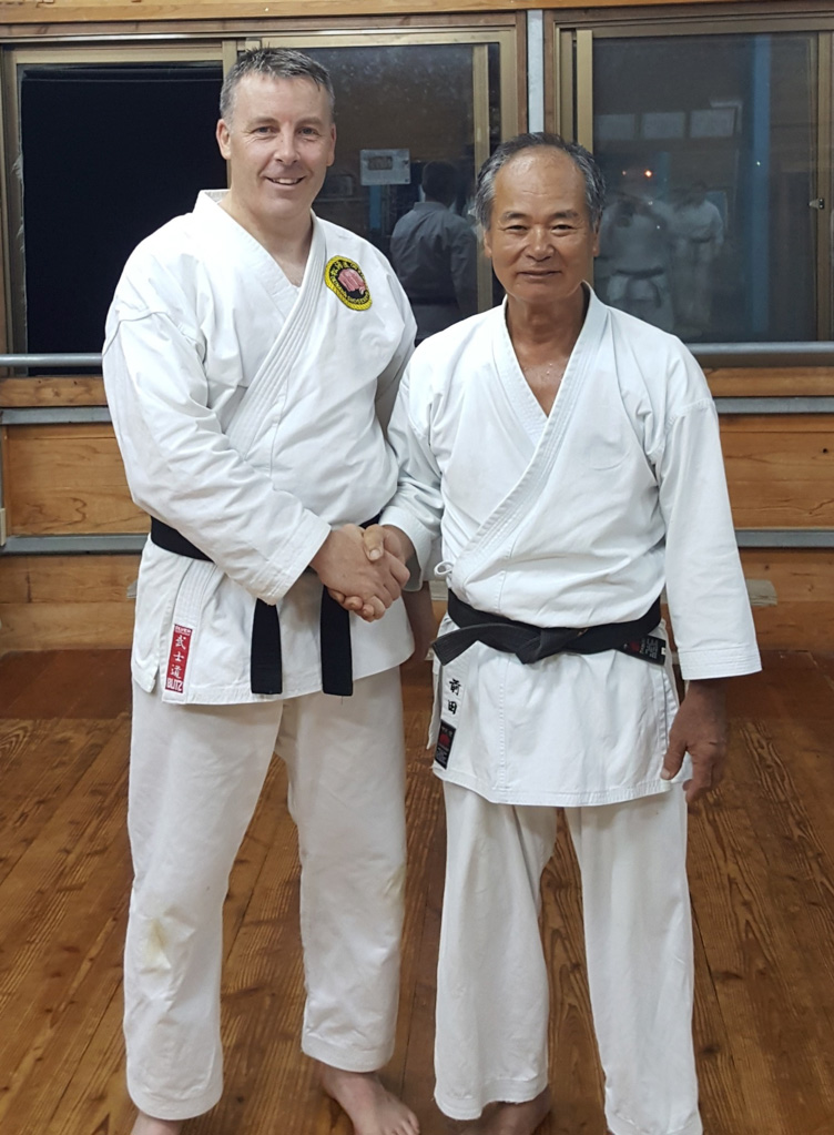 Aiden Thompson receives his black belt from Maeda Sensei in the Hombu dojo, Itoman City, Okinawa, June 2018